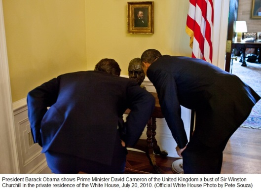 President Barack Obama shows Prime Minister David Cameron of the United Kingdom a bust of Sir Winston Churchill in the private residence of the White House, July 20, 2010. (Official White House Photo by Pete Souza)